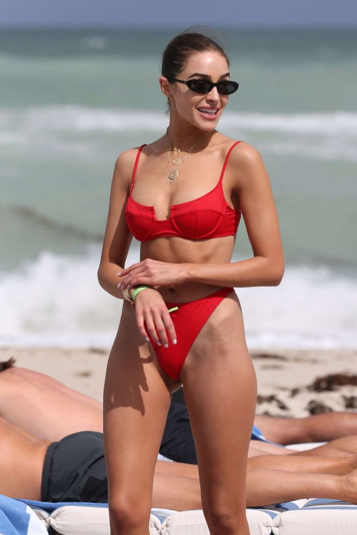 Olivia Culpo Relaxing In A Red Swimwear On The Miami Beach