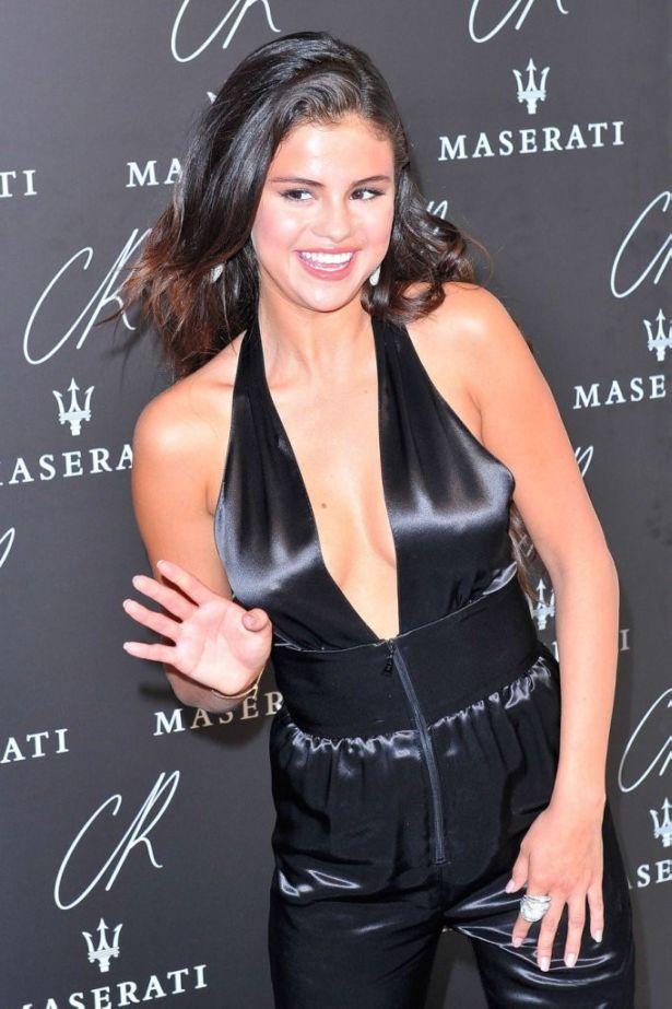 Selena Gomez Sports A Chic Jumpsuit